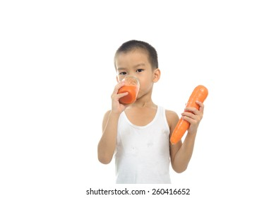 Young boy happy to drink carrot juice on white background