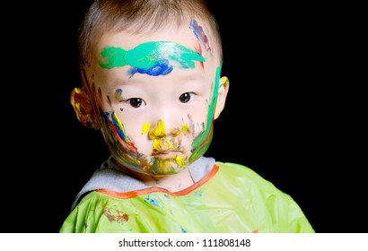 young boy has a colorful face when played color game