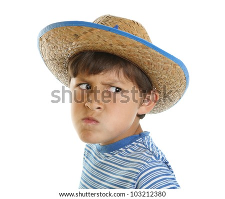 b3f42c7794e20 Young boy has a mad face while wearing a cowboy hat on a white background