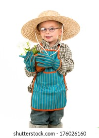 A young boy with a hat holds a plant.