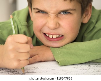 young boy hates doing homework