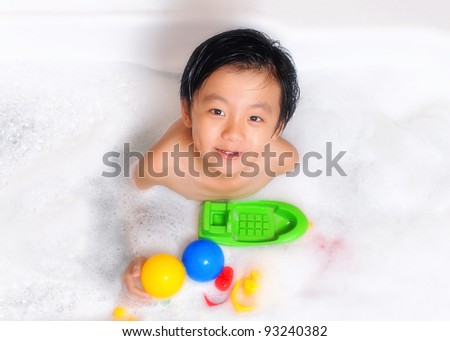 Hung boy plays with his toy