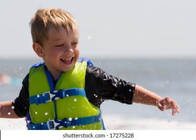 Young boy having fun in the ocean