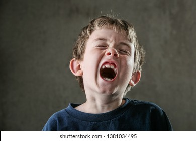 Young boy with his mouth wide open in a yell or yawn