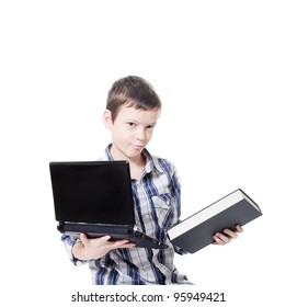 young boy holding a computer and a book
