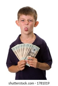 Young boy holding a fan of cash (all $20 bills) while sticking out his tongue. Isolated on a white background.