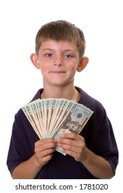 Young boy holding a fan of cash (all $20 bills) while smiling. Isolated on a white background.