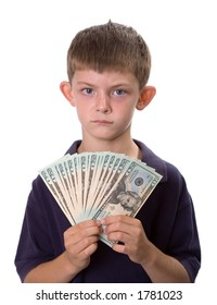 Young boy holding a fan of cash (all $20 bills) while frowning. Isolated on a white background.