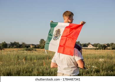 "Young boy holding flag of Mexico. ""September 16. Independence Day of Mexico. Mexican War of Independence, 1810."""