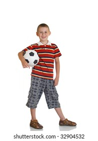 young boy holding football in his hand