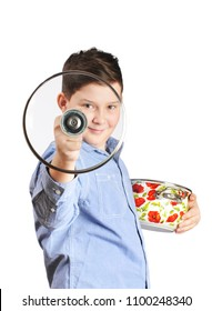 Young boy holding a glass lid and a pot with soup isolated on white background