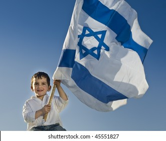 young boy holding the Israeli flag