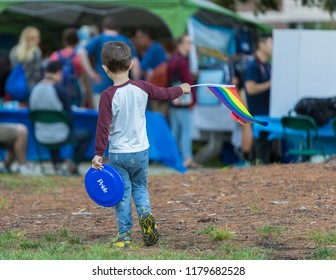 Young boy holding LGBT raimbow flag