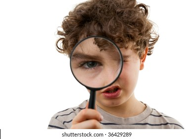 Young boy holding magnifying glass isolated on white background