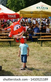 Young boy holding a Super Wings balloon during a child event with attractions on circa June 2018 in Rakoniewice, Poland.