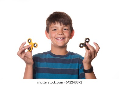 Young boy holding two fidget spinners
