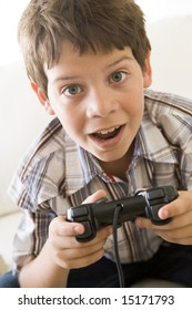 Young boy holding video game controller