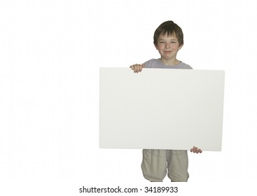 Young boy holds blank sign with room for copy text