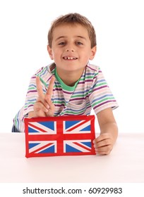 young boy holds a union jack pencil case in front of him