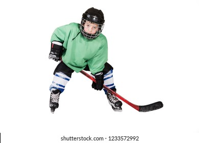 A young boy in ice hockey gear against isolated on white background. Boy playing ice hockey.