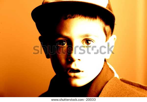 Young boy with intent look. Highly stylized washed in orange.