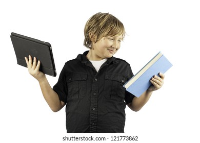 A young boy isolated on white holding a tablet pc and a book. Shows how times have changed.