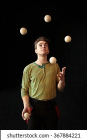 Young boy juggling