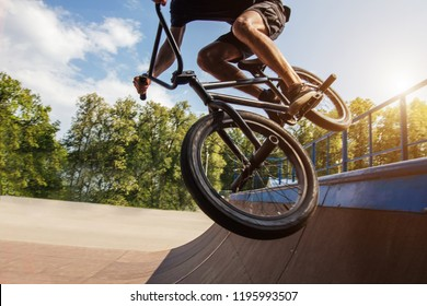 Young boy jumping with BMX Bike at skate park