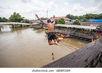 Young boy jumping into river
