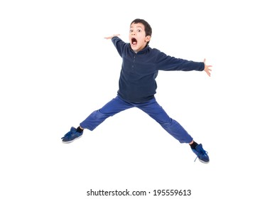 Young boy jumping isolated in white