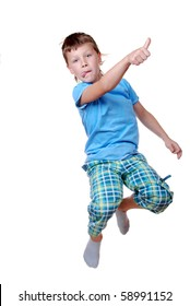 Young boy jumping over white background