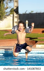 Young boy jumping in the pool