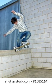 Young boy jumping with the skateboard