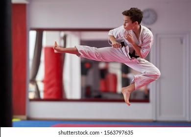 Young boy karate practitioner executing a kata