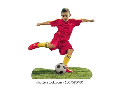 Young boy kicks the soccer ball. Isolated photo on white background. Football player in motion at studio. Fit jumping boy in action, jump, movement at game.
