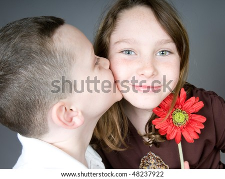 Young Boy Kissing Girl After Giving Stock Photo Edit Now 48237922
