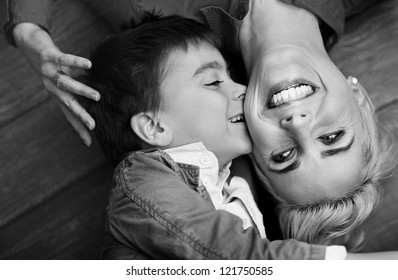 Young boy kissing her mum