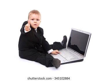 young boy with laptop showing thumbs up at camera isolated on white background