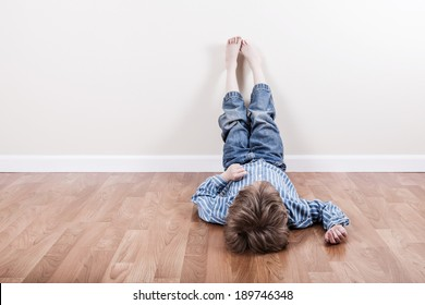 Young boy laying on the floor