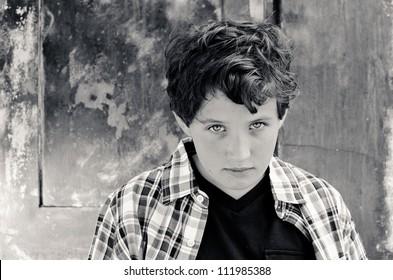 Young boy looking up at camera.