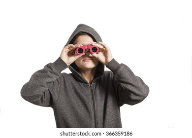 A young boy looking through binoculars