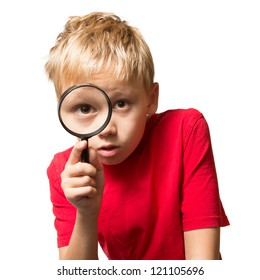 A Young Boy looking at You through the Magnifier Glass