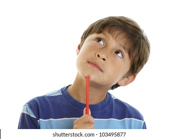 Young boy looks thoughtful with slight smile and gazes upwards while holding a pencil - on white background