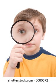 Young boy with magnifying glass isolated on white