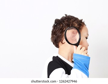 young boy with magnifying glass ready to explore stoch photo