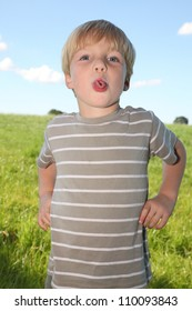 Young boy makes funny expression
