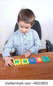 young boy makes his first word ''Learn''