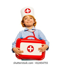 Young boy with medical cap and toy first-aid kit