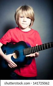 Young boy model with guitar