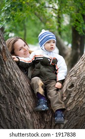 Young boy with mother in park. 4